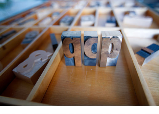 wood type drawer with letters 'q c p' standing on end
